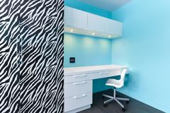 Zebra and white cabinets study desk Royalty Free Stock Photo