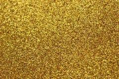 Zecchini dell'oro nei precedenti Struttura di scintillio dell'oro immagini stock libere da diritti