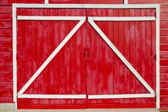 Zee Barn Doors. Red barn doors with the supports on the outside Royalty Free Stock Photography