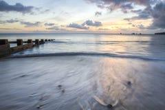 Zeegezichtzonsopgang in Swanage-baai Stock Afbeeldingen