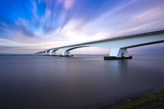 Free Zeeland Bridge - Long White Bridge Over The River, Beautiful Blue Sky With Dynamic Clouds. Long Time, Calm Water Of The Royalty Free Stock Photos - 187468998