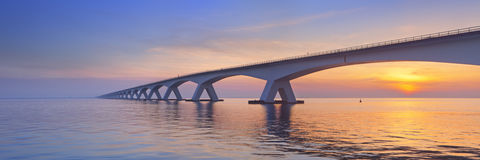 The Zeeland Bridge in Zeeland, The Netherlands at sunrise royalty free stock photos