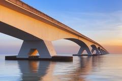 The Zeeland Bridge in Zeeland, The Netherlands at sunrise stock images