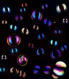 Zeepbels op donkere achtergrond Stock Foto's
