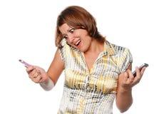 Zeer boos meisje en drie mobiele telefoons stock foto