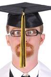 Zeer grappige graduatie een jonge mens Stock Foto's