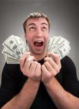 Zeer opgewekte mens met geld royalty-vrije stock foto