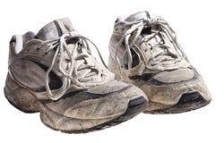 Zeer vuile en oude sportschoenen Stock Afbeelding