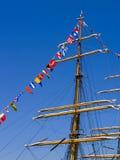 Zeevaart Vlaggen en Mast Stock Afbeelding