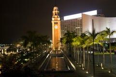 zegar Hong kongu nocy Kowloon tower Zdjęcie Royalty Free