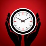 Zegar w mężczyzna ręce Obrazy Stock