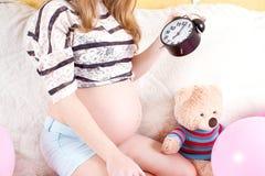 zegarowy kobieta w ciąży obrazy royalty free