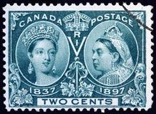 Zegel die portretten van jonge en oude Koningin Victoria tonen stock afbeeldingen