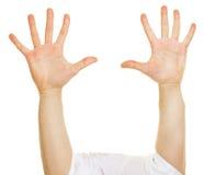 Zehn angehobene Finger auf zwei Händen Lizenzfreie Stockfotografie