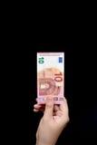 Zehn Eurorechnungen an Hand Stockfotos