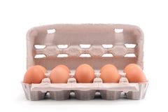 Zehn frische Eier in einem Kartonpaket Stockbild