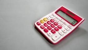 Zehn Stellen-erklärender Taschenrechner mit leerem Raum auf dem links Stockbild