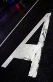 Zeichen auf Asphalt Lizenzfreie Stockbilder