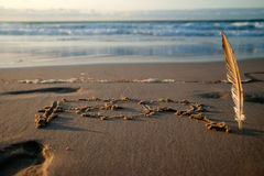Zeichen auf einem Strand Stockfoto