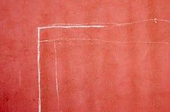Zeichen auf einer roten Wand Lizenzfreie Stockbilder