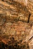Zeichen auf Höhlenwand Stockfoto
