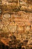 Zeichen auf Höhlenwand Stockbilder
