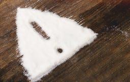 Zeichen der Aufmerksamkeit gemacht von granuliertem Zucker lizenzfreie stockbilder