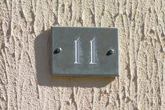 Zeichen der Hausnummer 11 Stockfotos