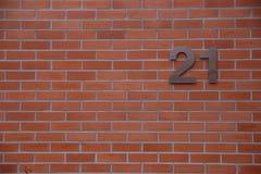 Zeichen der Hausnummer 21 auf Wand Stockfotografie