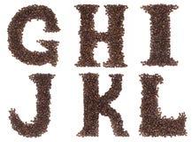Zeichen des Alphabetes gebildet von den Kaffeebohnen Lizenzfreie Stockbilder