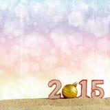 Zeichen des neuen Jahres 2015 auf Sand Stockbilder