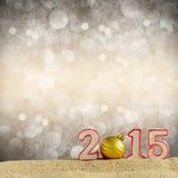 Zeichen des neuen Jahres 2015 auf Sand Lizenzfreies Stockbild