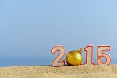 Zeichen des neuen Jahres 2015 auf Sand Stockfoto