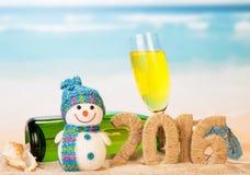 Zeichen des neuen Jahres mit Champagner Stockfoto