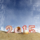 Zeichen des neuen Jahres 2015 mit Muschel-, Starfish- und Weihnachtsball Stockbilder