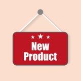 Zeichen des neuen Produktes mit dem Schatten, der an einem hellen Hintergrund hängt Stockfoto