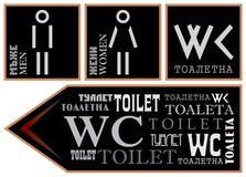 Zeichen für verschiedene Sprachen und Güsse der Toilette Stockbild