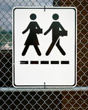 Zeichen - Mann und Frau, die mit Aktenkoffern gehen Stockbild
