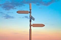 Zeichen und Sonnenuntergang Lizenzfreies Stockfoto