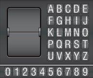 Zeichen und Zahlen auf mechanischer Anzeigetafel Lizenzfreie Stockbilder