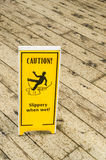 Zeichen-Warnung gegen glatten Boden Stockbilder