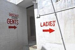 Zeichendamen für die allgemeine Toilette Stockfotografie