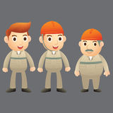 Zeichentrickfilm-Figur mit drei Ingenieuren Stockbild