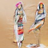 Zeichnen auf Papier von zwei traditionellen bulgarischen Frauen Lizenzfreies Stockfoto
