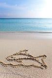Zeichnen auf Sand auf einem Thema des Restes - Fisch Lizenzfreies Stockbild