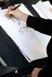 Zeichnen einer Karikatur Lizenzfreie Stockfotos