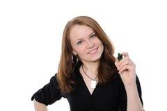 Zeichnung der jungen Frau etwas auf Bildschirm mit einer Feder Stockbilder