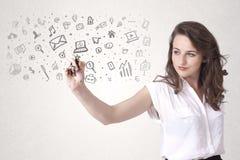Zeichnung der jungen Frau und skizzieren Ikonen Lizenzfreie Stockfotos