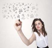 Zeichnung der jungen Frau und skizzieren Ikonen und Symbole Lizenzfreie Stockfotografie