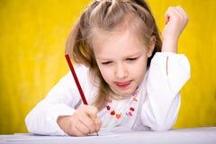 Zeichnungs-Schulmädchen Stockfotografie